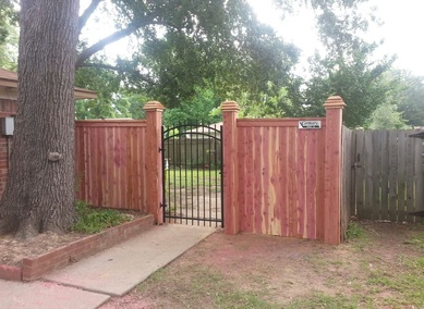 Custom wood fence iron gate
